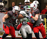 SIOUX FALLS, SD - MAY 4:  Justin Belotti #20, Tyler Knight #3, and Dan O'Keefe #18 from the Sioux Falls Storm combine on a tackle of Ramonce Taylor #3 from the Nebraska Danger in the second quarter of their game Saturday night at the Sioux Falls Arena. (Photo by Dave Eggen/Inertia)