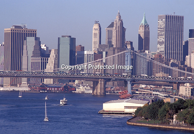COAMENY35087.Country. Americ. New York. Brooklyn Bridge  over the sea, boats on the water, skyscrapers, city in the background. 10/98..©Per-Anders Pettersson / iAfrika Photos