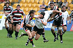 Kane Hancy fends off Karl Lowe as he heads for the tryline during the Air New Zealand Cup rugby game between Counties Manukau & Hawkes Bay played at Mt Smart Stadium, 30th of September 2006. Hawkes Bay won 30 - 29.