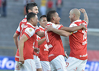 BOGOTÁ -COLOMBIA, 06-09-2014. Jugadores de Independiente Santa Fe celebran un gol anotado a Deportes Tolima durante partido por la fecha 8 de la Liga Postobón  II 2014 jugado en el estadio Nemesio Camacho el Campín de la ciudad de Bogotá./ Players of Independiente Santa Fe celebrate a goal against Deportes Tolima during match for the 8th date of the Postobon League II 2014 played at Nemesio Camacho El Campin stadium in Bogotá city. Photo: VizzorImage/ Gabriel Aponte / Staff