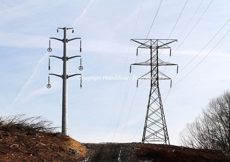 MIDDLEBURY, CT.- 01 FEBRUARY 2014 - 020114JW02 - A new electrical transmission line pole rises up next to an old one as part of the transmission line upgrade that Northeast Utilities is doing from Watertown to Sherman.<br /> Jonathan Wilcox Republican-American