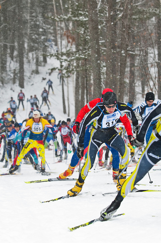 Skiers compete in the Noquemanon Ski Marathon cross country Nordic ski race from Ishpeming to Marquette Michigan.