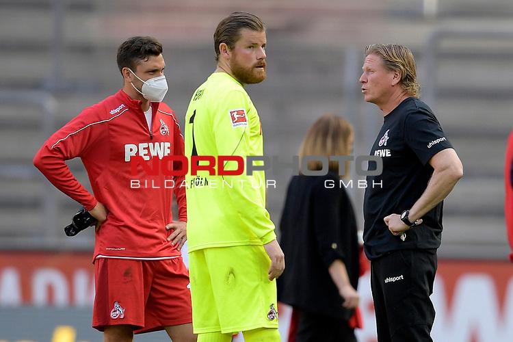 nph00351: v.re:Markus GISDOL (Trainer 1.FC Koeln),<br /> Timo HORN  (Torwart 1.FC Koeln),<br /> Jonas HECTOR (1.FC Koeln)<br /> nach Spielende.<br /> Sport: Fussball: 1. Bundesliga: Saison 19/20: 26.Spieltag: 1.FC KOELN-FSV MAINZ 05,17.05.2020.<br /> Foto: Anke Waelischmiller/SVEN SIMON/POOL / via Meuter/nordphoto<br /> <br /> Nur für journalistische Zwecke! Only for editorial use!<br /> Gemäß den Vorgaben der DFL Deutsche Fußball Liga ist es untersagt, in dem Stadion und/oder vom Spiel angefertigte Fotoaufnahmen in Form von Sequenzbildern und/oder videoähnlichen Fotostrecken zu verwerten bzw. verwerten zu lassen. DFL regulations prohibit any use of photographs as image sequences and/or quasi-video.