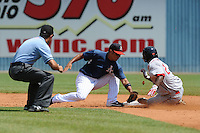 Joey Wong applies the tag on a sliding Wilfred Picardo as Aaron Roberts prepares to ring him up during a game against the Greenville Drive at McCormick Field, Asheville, NC August 15, 2010. Greenville won the game 10-6.