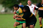 D. Tevita is engulfed by Bombay's prop T. Matai.  Counties Manukau Premier Club Rugby, Drury vs Bombay played at the Drury Domain, on the 14th of April 2006. Bombay won 34 - 13.
