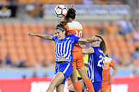 Houston, TX - Wednesday June 28, 2017: Carli Lloyd heads the ball over Angela Salem during a regular season National Women's Soccer League (NWSL) match between the Houston Dash and the Boston Breakers at BBVA Compass Stadium.