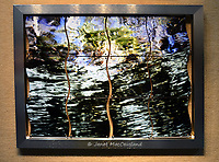 This unique work of an underwater image is printed on multiple aluminum shapes linked together shimmering within a metal frame.