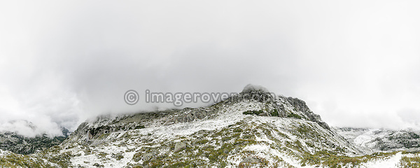 Switzerland, Western Europe, Berner Oberland, Susten region nr. Gadmen. Sustenpass. First snow on the western ascent from Gadmen towards the top of the Susten mountain pass. Note: This is a digitally stitched panoramic image.