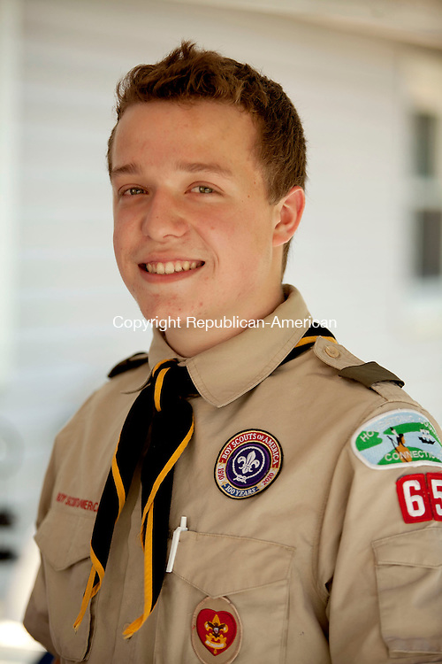 SOUTHBURY, CT-26 August 2014-082214BF10- Chris Denslow, 16, from Oxford, who is a member of Boy Scout Troop 65 in Seymour-Oxford, is collecting donations for his Eagle Scout project called Comfort for Kids. He is shown with a donation of Bennie Babies animals that were donated by Jean Hoyt of Southbury.  Bob Falcetti Republican-American