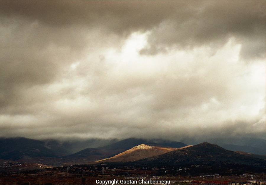Spain landscape on a cloudy day, mountain touched by a ray of light
