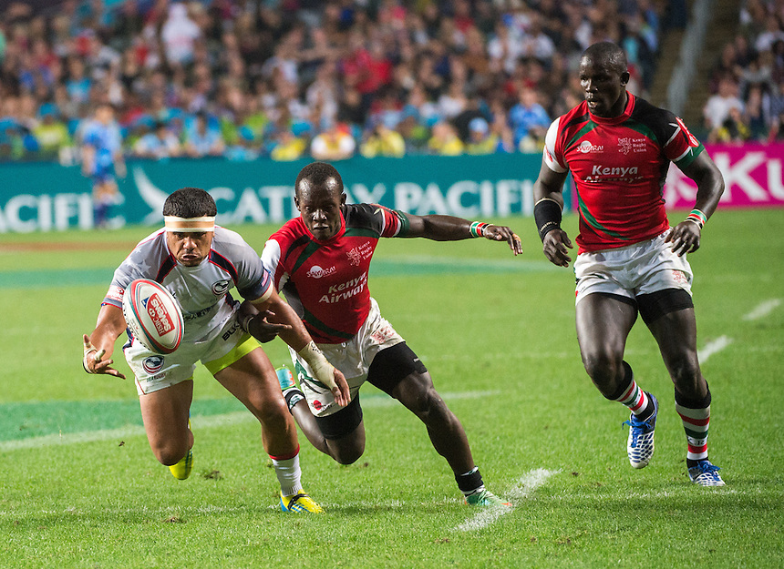 Folau Niua from USA stretches for the ball.USA vs Kenya Hong Kong Rugby 7's.27.03.15. 27th March 2015.