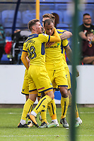 Wes Thomas of Oxford United (right) celebrates after he scores his team's second goal of the game to make the score 1-2 during the Sky Bet League 1 match between Peterborough and Oxford United at the ABAX Stadium, London Road, Peterborough, England on 30 September 2017. Photo by David Horn.