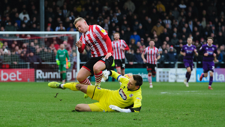 Lincoln City's Danny Rowe is fouled by Grimsby Town's James McKeown, leading to the Grimsby Town goalkeeper being shown a red card by referee Mike Dean<br /> <br /> Photographer Chris Vaughan/CameraSport<br /> <br /> The EFL Sky Bet League Two - Lincoln City v Grimsby Town - Saturday 19 January 2019 - Sincil Bank - Lincoln<br /> <br /> World Copyright &copy; 2019 CameraSport. All rights reserved. 43 Linden Ave. Countesthorpe. Leicester. England. LE8 5PG - Tel: +44 (0) 116 277 4147 - admin@camerasport.com - www.camerasport.com