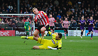 Lincoln City's Danny Rowe is fouled by Grimsby Town's James McKeown, leading to the Grimsby Town goalkeeper being shown a red card by referee Mike Dean<br /> <br /> Photographer Chris Vaughan/CameraSport<br /> <br /> The EFL Sky Bet League Two - Lincoln City v Grimsby Town - Saturday 19 January 2019 - Sincil Bank - Lincoln<br /> <br /> World Copyright © 2019 CameraSport. All rights reserved. 43 Linden Ave. Countesthorpe. Leicester. England. LE8 5PG - Tel: +44 (0) 116 277 4147 - admin@camerasport.com - www.camerasport.com