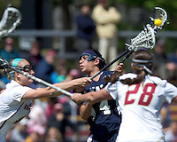 Yale University attacker Kerri Fleishhacker (4) shoots the ball. Boston College defeated Yale University, 16-5, at Newton Campus Field, April 28, 2012.
