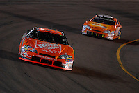 Apr 22, 2006; Phoenix, AZ, USA; Nascar Nextel Cup driver Tony Stewart of the (20) Home Depot Chevrolet Monte Carlo leads Clint Bowyer during the Subway Fresh 500 at Phoenix International Raceway. Mandatory Credit: Mark J. Rebilas-US PRESSWIRE Copyright © 2006 Mark J. Rebilas.