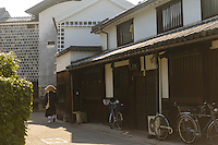 A monk walks past historic buildings, Kurashiki, Okayama Prefecture, Japan, July 11, 2013. The historic city of Kurashiki is popular with tourists for its fine Edo Period(1603-1868) and Meiji Period (1868-1912) architecture.