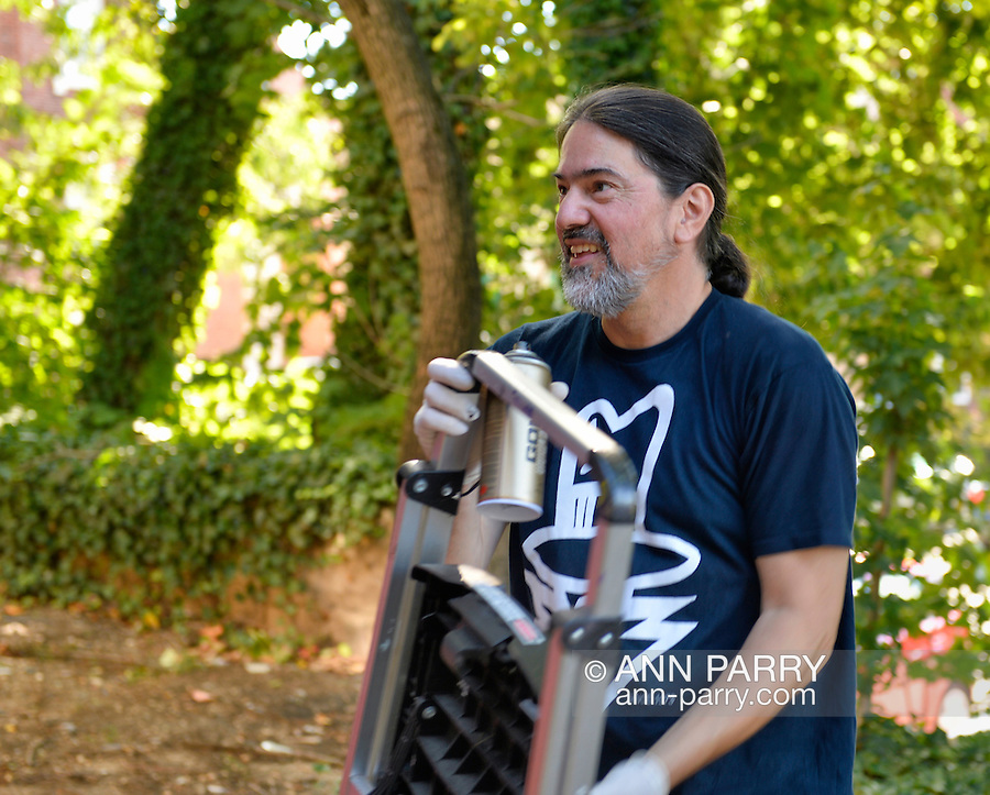 """Huntington, New York, U.S. 24th August 2013. SONIC BAD, legendary street artist JESSE RODRIGUEZ from the Bronx, is bringing equipment, a spray can and step ladder, to graffiti paint the """"Art Matters"""" wall, on the back of the Huntington Arts Council building, during the the art event """"Off the Walls"""" Block Party, by SPARKBOOM,, a project the council created to help emerging artists, showcase talents, and help its artistic family network."""