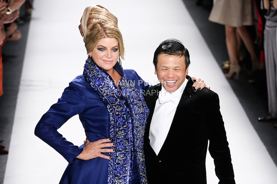 Actress Kirstie Alley, and designer Zang Toi, walk runway together at the close of the Zang Toi Spring 2012 My Dream Of North Africa Collection fashioin show, during Mercedes-Benz Fashion Week Spring 2012.