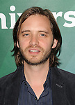 Aaron Stanford arriving at the NBCUniversal Summer TCA 2014 Day 2 held at The Beverly Hilton Hotel Beverly Hills, CA. July 14, 2014.
