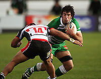 Manawatu captain Nick Crosswell runs into the tackle of Lelia Masaga during the Air NZ Cup rugby match between Manawatu Turbos and Counties-Manukau Steelers at FMG Stadium, Palmerston North, New Zealand on Sunday, 2 August 2009. Photo: Dave Lintott / lintottphoto.co.nz