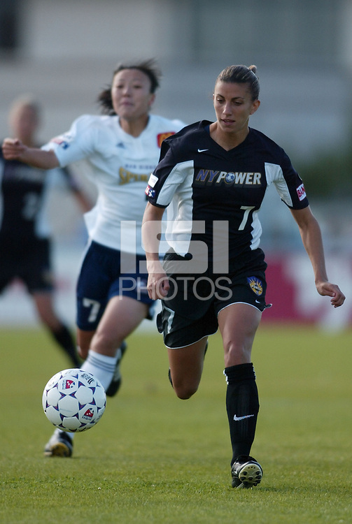 Sara Whalen of the New York Power being chased by Zhang Ouying of the San Diego Spirit during their May 25th game at Mitchel Athletic Complex. Sara Whalen had an assist during the Power's 2-1 win.