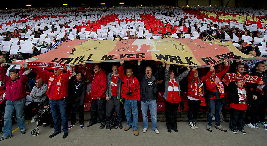 Fans hold aloft a banner in tribute to the ninety six people who died in the 1989 Hillsborough disaster..Football - Barclays Premiership - Liverpool v Manchester United - Sunday 23rd September 2012 - Anfield - Liverpool..