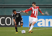 Chivas USA forward Sacha Kljestan (16) shields the ball against DC United midfielder Andy Najar (14).  DC United defeated Chivas USA 3-2 at RFK Stadium, Saturday  May 29, 2010.