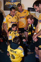 Prince Harry chats with Chris Smylie's kids, Noah and Eli, in the changing rooms after the Super Rugby match between the Hurricanes and Sharks at Westpac Stadium, Wellington, New Zealand on Saturday, 9 May 2015. Photo: Dave Lintott / lintottphoto.co.nz
