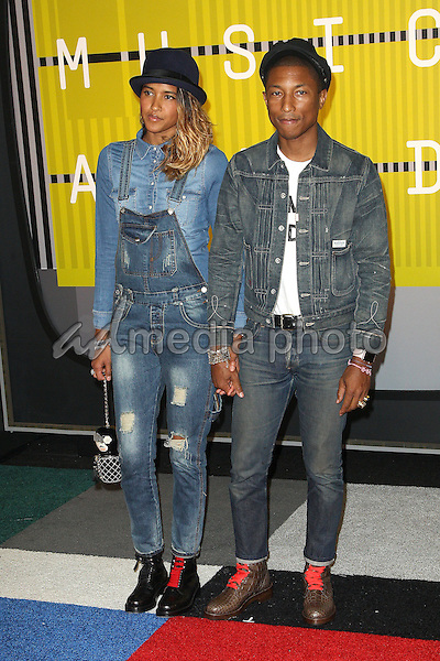 30 August 2015 - Los Angeles, California - Helen Lasichanh, Pharrell Williams. 2015 MTV Video Music Awards - Arrivals held at Microsoft Theater. Photo Credit: AdMedia