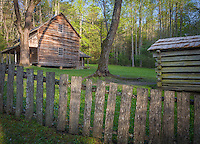 Great Smoky Mts. National Park, TN/NC<br /> Farm house smoke house and weathered wood fence at &quot;The Tipton place&quot; farm site in Cades Cove
