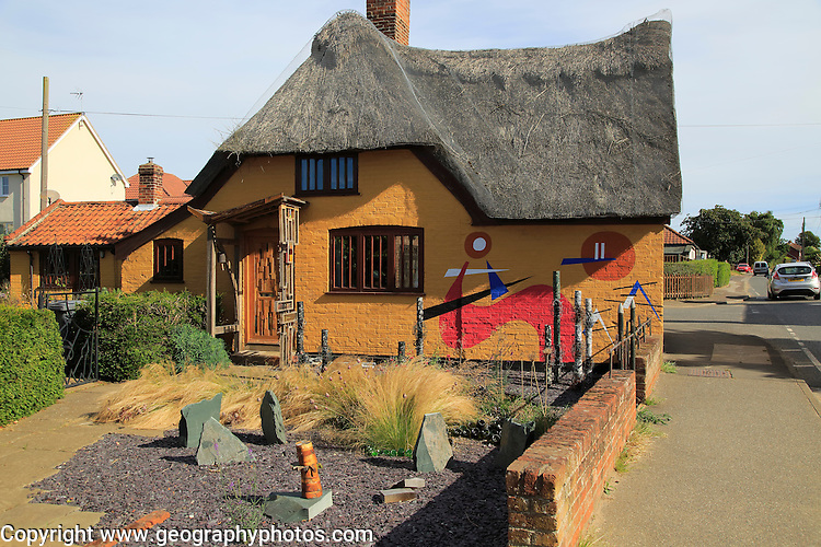 Traditional thatched house with modern art design, Hollesley, Suffolk, England, UK