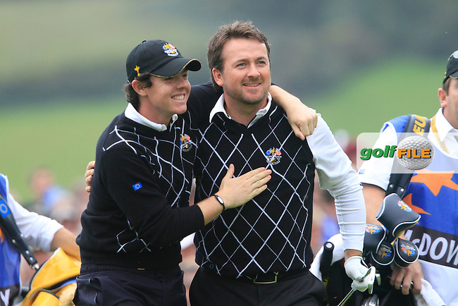 Graeme McDowell and Rory McIlroy after driving off on the 17th tee in the Session 2 Foursomes Match 6 during Day 2 of the The 2010 Ryder Cup at the Celtic Manor, Newport, Wales, 2nd October 2010..(Picture Eoin Clarke/www.golffile.ie)