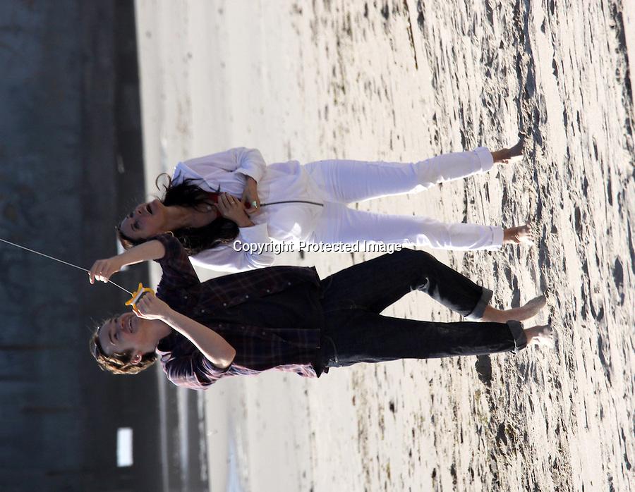 February 22st 2011  ..Courteney Cox & co star Byrd Dan hugging & flirting while playing on the beach & shoveling sand & building sand castles & flying a kite at in Malibu California ...AbilityFilms@yahoo.com.805-427-3519.www.AbilityFilms.com.