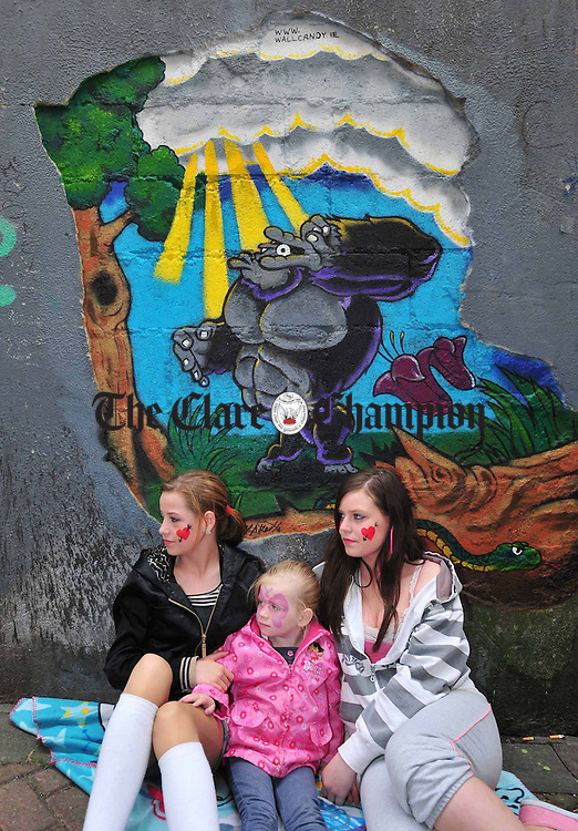 Cyystal, Destiny and Leanne Sherlock enjoying the Ennis Street Festival on Saturday. Photograph by Declan Monaghan
