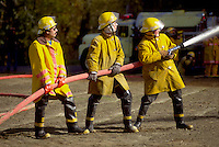 Firefighters with hose.