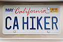 Close Up of 'CA HIKER' (California Hiker) personalized license plate on a Honda Accord car. The Bay Area couple who own the vehicle, you guessed it, love to hike. People pay for the customized plates and the proceeds support various causes. The fees collected for these white custom plates go to support environmental programs in California, USA