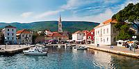 Panoramic photo of Jelsa Harbor, Hvar Island, Dalmatia (Dalmacija), Croatia. This is a panoramic photo of Jelsa Harbor on Hvar Island in the Dalmatia region (Dalmacija) of Croatia. From Jelsa harbor on Hvar Island, you can catch the tourist boat ferry to Brac Island.