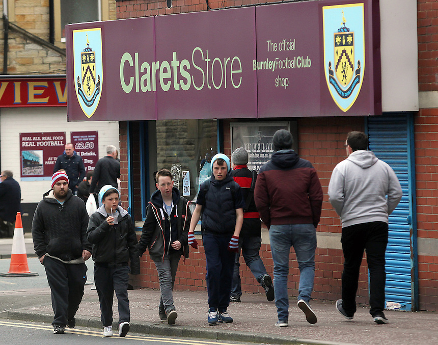 Burnley fans arrive at Turf Moor<br /> <br /> Photo by Rich Linley/CameraSport<br /> <br /> Football - The Football League Sky Bet Championship - Burnley v Middlesbrough - Saturday 12th April 2014 - Turf Moor - Burnley<br /> <br /> &copy; CameraSport - 43 Linden Ave. Countesthorpe. Leicester. England. LE8 5PG - Tel: +44 (0) 116 277 4147 - admin@camerasport.com - www.camerasport.com