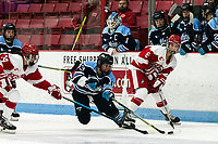 BOSTON, MA - JANUARY 04: Maddie Giordano #13 of University of Maine loses her edge as Kristina Schuler #14 of Boston University and Deziray De Sousa #8 of Boston University defend during a game between University of Maine and Boston University at Walter Brown Arena on January 04, 2020 in Boston, Massachusetts.