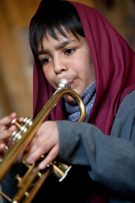 18 May 2012, Kabul Afghanistan: Orphan student Meenaa Zinat (9) practises trumpet during a lesson at the National Institute of Music. Dr Ahmad Nasir Sarmast founded the Afghanistan National Institute of Music in Kabul that takes in students from all walks of Afghan life to educate them in musical studies. The World Bank is supporting this legacy by providing funding for a new concert hall and to gather additional land to expand the premises. Many of the students are orphans who would otherwise have no opportunity or access to the knowledge or instruments that the Institute has gathered. Up to half a dozen ex-patriate music  teachers run classes in music that ranges from traditional Afghan and classical  music to modern rock.  Picture by Graham Crouch/World Bank