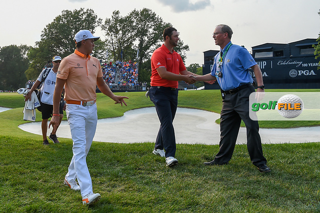 Rickie Fowler (USA) and Jon Rahm (ESP) depart 18 following the 4th round of the 100th PGA Championship at Bellerive Country Club, St. Louis, Missouri. 8/12/2018.<br /> Picture: Golffile | Ken Murray<br /> <br /> All photo usage must carry mandatory copyright credit (© Golffile | Ken Murray)
