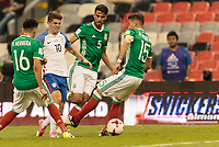 Mexico City, Mexico - Sunday June 11, 2017: Hector Herrera, Christian Pulisic, Diego Reyes, Hector Moreno during a 2018 FIFA World Cup Qualifying Final Round match with both men's national teams of the United States (USA) and Mexico (MEX) playing to a 1-1 draw at Azteca Stadium.