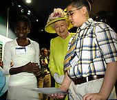 """Queen Elizabeth II talks with students at a NASA Explorer School Workshop, at the NASA Goddard Spaceflight Center, Tuesday, May 8, 2007, in Greenbelt, Md.  Queen Elizabeth II and her husband, Prince Philip, Duke of Edinburgh, visited the NASA Goddard Space Flight Center as one of the last stops on their six-day United States visit.  Photo Credit: """"NASA/Pat Izzo"""""""