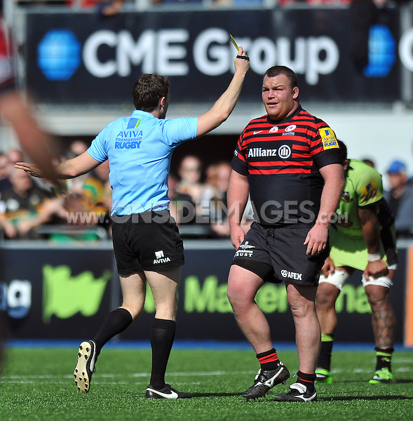 Matt Stevens is shown a yellow card for cynical play by referee Luke Pearce. Aviva Premiership match, between Saracens and Northampton Saints on April 13, 2014 at Allianz Park in London, England. Photo by: Patrick Khachfe / JMP