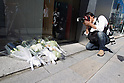 October 6, 2011: Tokyo, Japan - A press photographer takes a pictures of flowers that is left for the late Steve Jobs, founder and former CEO of Apple Inc., outside the Apple store in the Ginza shopping district of Tokyo. Jobs passed away in the United States at the age of 56 after a long battle with cancer. (Photo by Christopher Jue/AFLO)