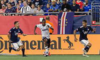 FOXBOROUGH, MA - JUNE 27: Fabrice-Jean Picault #9 dribbles as Diego Fagundez #14 and Brandon Bye #15 close during a game between Philadelphia Union and New England Revolution at Gillette Stadium on June 27, 2019 in Foxborough, Massachusetts.