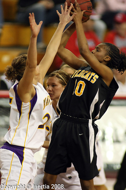 VERMILLION, SD - MARCH 15: Laquisha Cook #10 of Wayne State looks for the shot over Alex Andrews #25 of Minnesota State in the second half of their North Central Regional semifinal game Saturday afternoon at the DakotaDome in Vermillion. (Photo by Dave Eggen/Inertia)