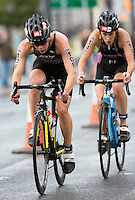 10 AUG 2014 - LIVERPOOL, GBR - Sophie Coldwell (left) and Jessica Learmonth (right) attempt to extend their lead over the chasing pack during the elite women's wave at the Tri Liverpool triathlon in Kings Dock, Liverpool, Great Britain (PHOTO COPYRIGHT © 2014 NIGEL FARROW, ALL RIGHTS RESERVED)