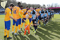 Players ahead of the Sky Bet League 2 match between Wycombe Wanderers and Mansfield Town at Adams Park, High Wycombe, England on 25 March 2016. Photo by David Horn.